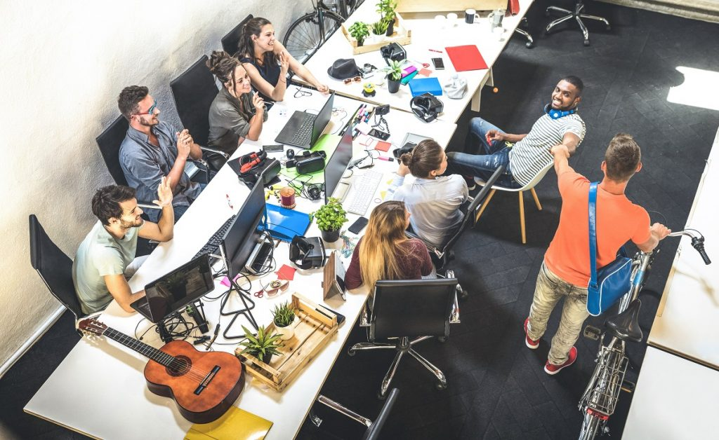 Employee workers group having fun at urban alternative studio wi