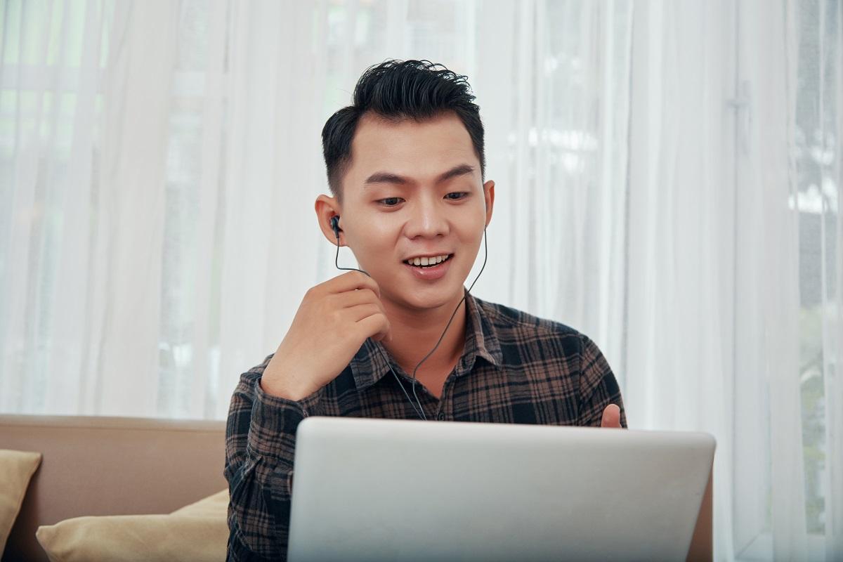 Asian man having video call at home