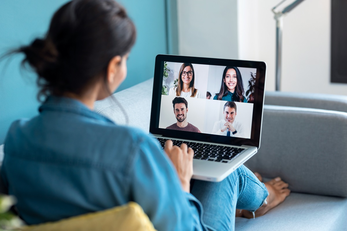 Business woman speaking on video call with diverse colleagues on
