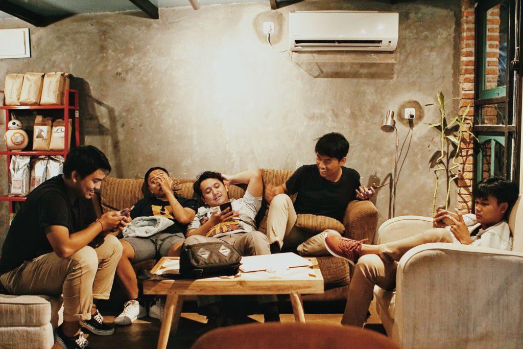 men-sits-of-sofa-1036804